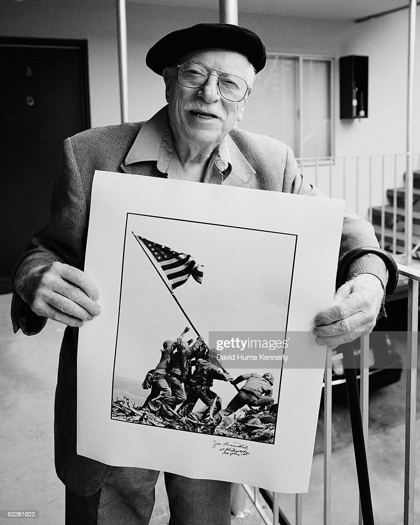Photographer Joe Rosenthal poses July 1, 200O in San Francisco, California with his Pulitzer Prize-winning photograph of U.S. Marines raising the flag on Mount Suribachi, Iwo Jima.