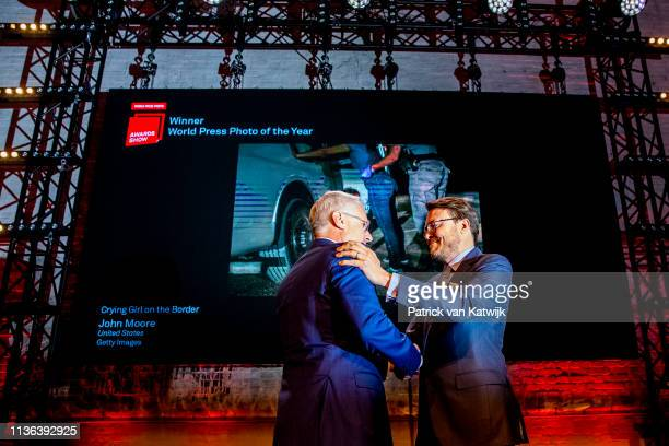 Photographer John Moore receives the World Press Photo of the Year from Prince Constantijn of The Netherlands during the World Press Photo Award...