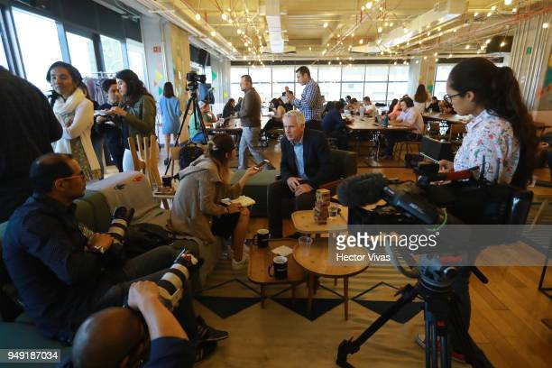 Photographer John Moore talks with the press during the launch event of Undocumented book at WeWork Varsovia Building on April 19 2018 in Mexico City...