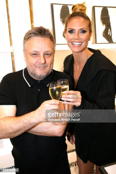 Photographer John Rankin Waddell aka Rankin and Heidi Klum attend 'Heidi Klum by Rankin' Heidi Klum Rankin launch book at Supra Paris Store on May 26...