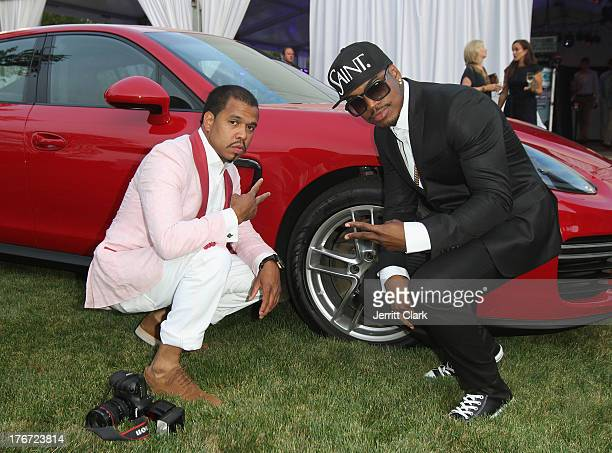 Photographer Johnny Nunez and NeYo pose next to a Porsche Panamera GTS at the 2nd annual Compound Foundation Fostering A Legacy Benefit on August 17...