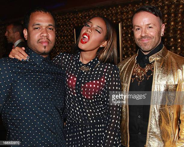 Photographer Johnny Nunez Angela Simmons and Legendary Damon attend the Skyy Infusions Moscato Launch Event at Gold Bar on May 7 2013 in New York City
