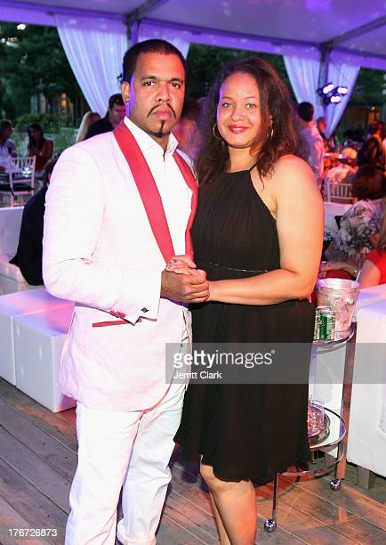 Photographer Johnny Nunez poses with his wife at the 2nd annual Compound Foundation Fostering A Legacy Benefit on August 17 2013 in East Hampton New...