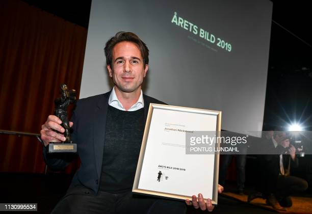Photographer Jonathan Nackstrand of Agence FrancePresse poses after he was awarded the Swedish Press Photography Arets Bild 2018/2019 prize on March...