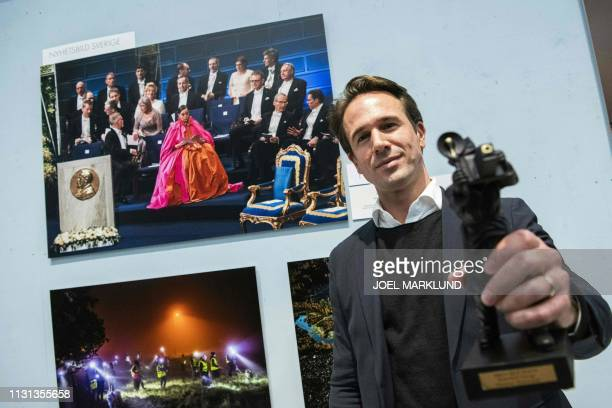 Photographer Jonathan Nackstrand of Agence FrancePresse poses in front of his winning picture after he was awarded the Swedish Press Photography...