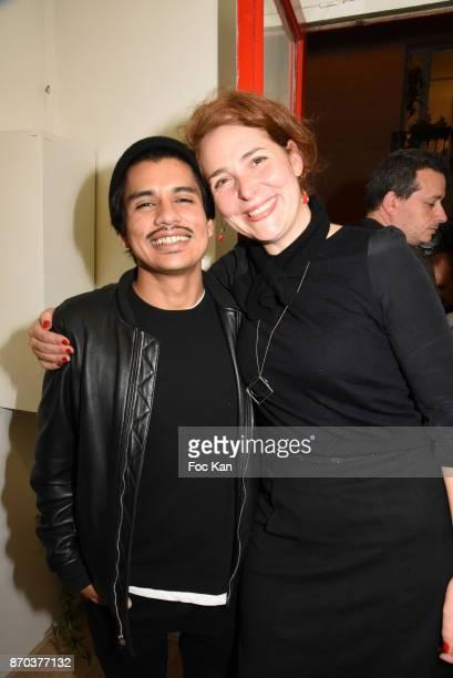 Photographer Jonathan Velasquez and Galerie Andre Antoine PR Sarah Aguilar pose during the Larry Clark and Jonathan Velasquez Photo Exhibition as...