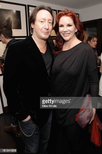 Photographer Julian Lennon and Melissa Gilbert attend the Julian Lennon Timeless Exhibition at Morrison Hotel Gallery on February 9 2013 in West...