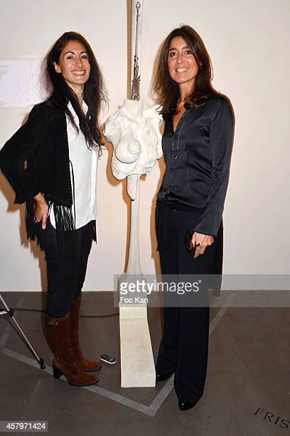 Photographer Karine Zibaut and Skin President and cofounder Cecile Reboul Cleach pose with 'La Venus D'Hippocrate' a sculpture of Nicolas Aubry...