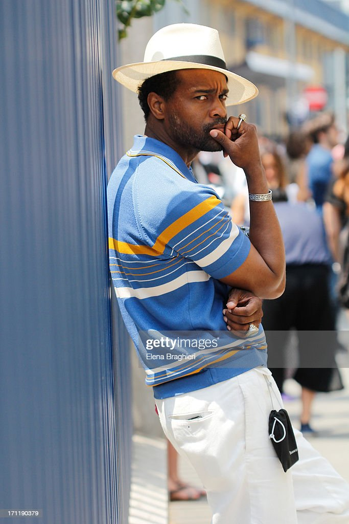 Photographer Karl-Edwin Guerre is seen at Milan Fashion Week Menswear Spring/Summer 2014 on June 22, 2013 in Milan, Italy.