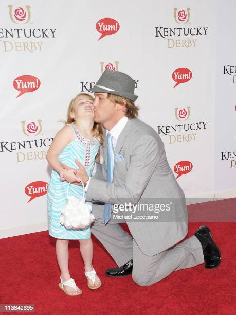 Photographer Larry Birkhead and daughter Dannielynn Birkhead attend the 137th Kentucky Derby at Churchill Downs on May 7 2011 in Louisville Kentucky
