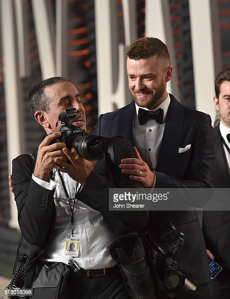 Photographer Larry Busacca and recording artist Justin Timberlake arrive at the 2016 Vanity Fair Oscar Party Hosted By Graydon Carter at Wallis...