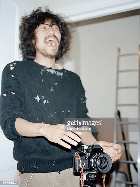 A photographer laughing in a studio