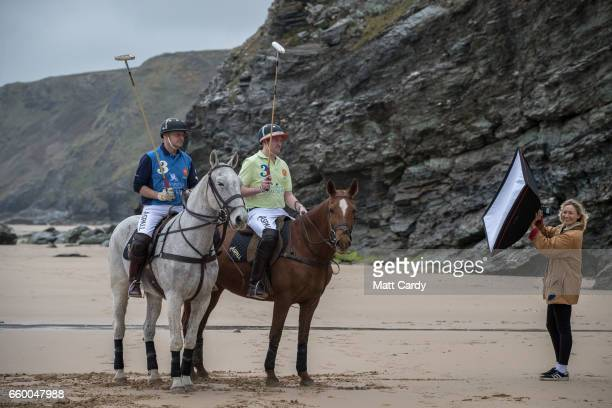 A photographer lights a photograph as Andy Burgess riding Tonka and Daniel Loe riding La Sofia practice for the forthcoming Aspall Polo on the Beach...