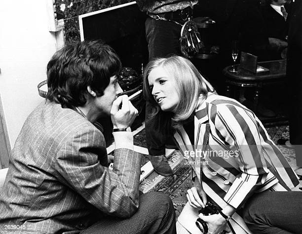 Photographer Linda Eastman talks to Beatle Paul McCartney at the press launch of the Beatles new album 'Sergeant Pepper's Lonely Hearts Club Band'...