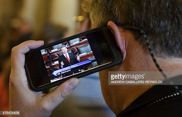 A photographer listens as Senator Rand Paul RKY speaks in the Senate chambers at the US Capitol in Washington DC on May 31 2015 Crucial national...