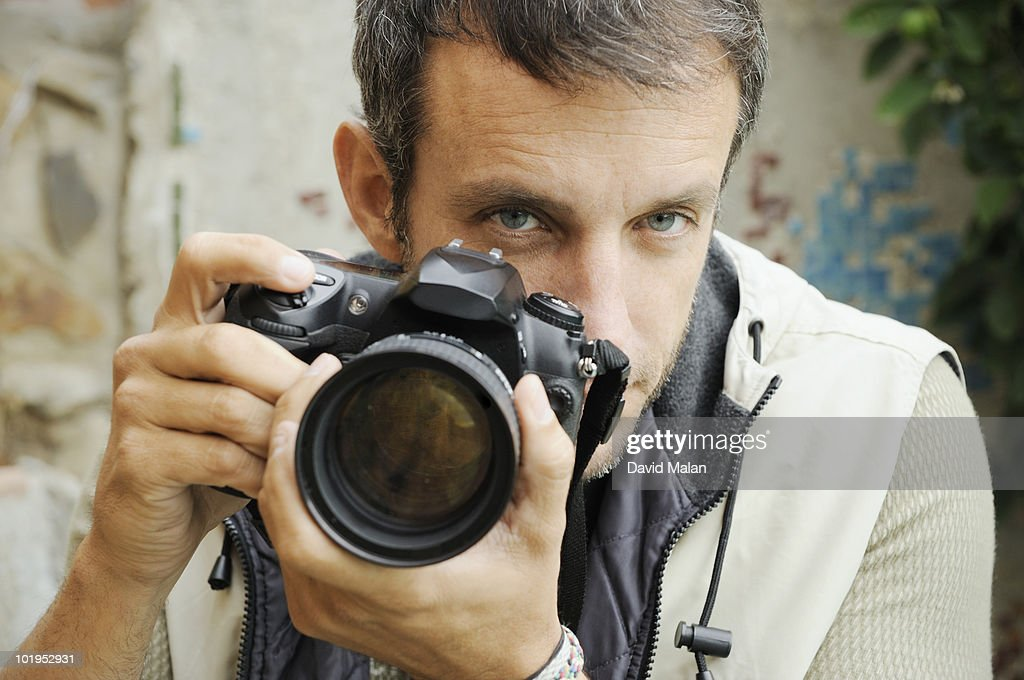 Photographer looking over lens. : Stock Photo