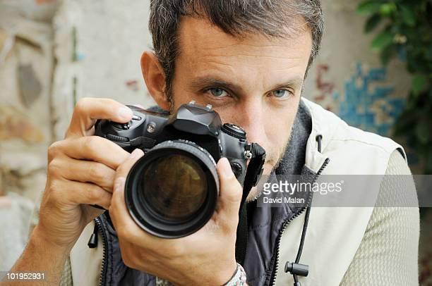 photographer looking over lens. - 写真家 ストックフォトと画像