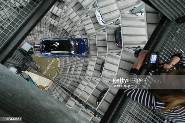 Photographer looks down at a Volkswagen ID.4 electric car standing on an elevator platform inside one of the twin towers used as storage at the...