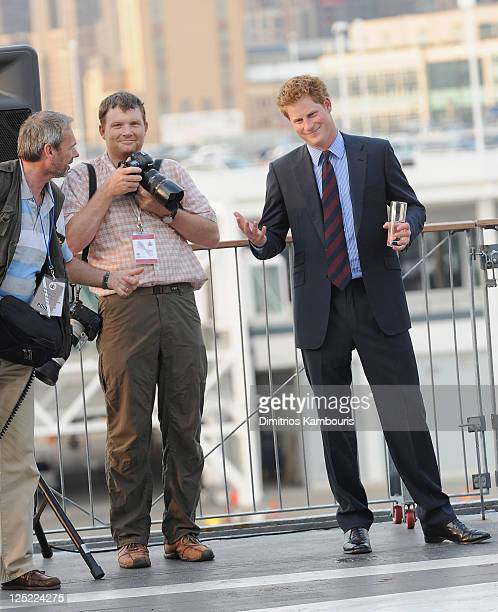 Photographer Lucas Jackson and HRH Prince Harry visit the Intrepid Sea-Air-Space Museum on June 25, 2010 in New York City.
