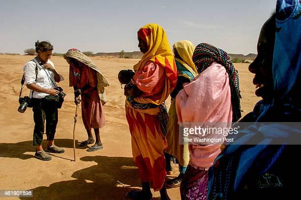 Photographer Lynsey Addario talks with internally displaced people in the Shigek Karo region of northern Darfur Sudan
