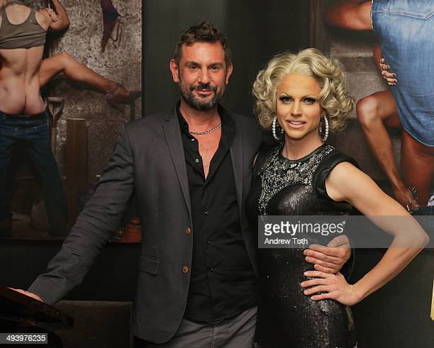 Photographer Magnus Hastings and Courtney Act attend the private viewing and launch party for Why Drag at the Out Hotel on May 26 2014 in New York...