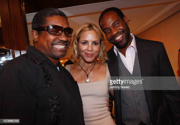 Photographer Marc Baptiste actress Maria Bello and restauranteur and club owner Unik Ernest attend Judith Leiber's Haiti Pendant Initiative on July...