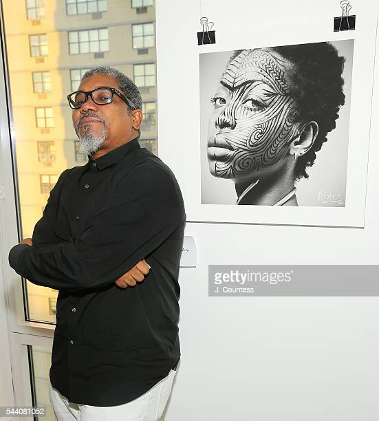 Photographer Marc Baptiste poses for a photo at the 'Other Color' By Marc Baptiste Opening at the apART Private Gallery on June 30 2016 in New York...