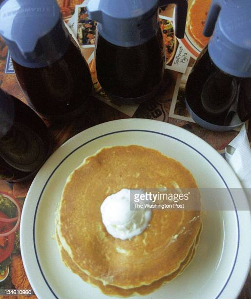 Marie Poirier MarziFTWP / Location 9680 Baltimore Ave Caption Detail shot of a stack of pancakes and four kinds of syrupbutter pecan old fashioned...