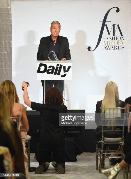 Photographer Mario Testino accepts the award for Creative of the Year onstage during the Daily Front Row's Fashion Media Awards at Four Seasons Hotel...