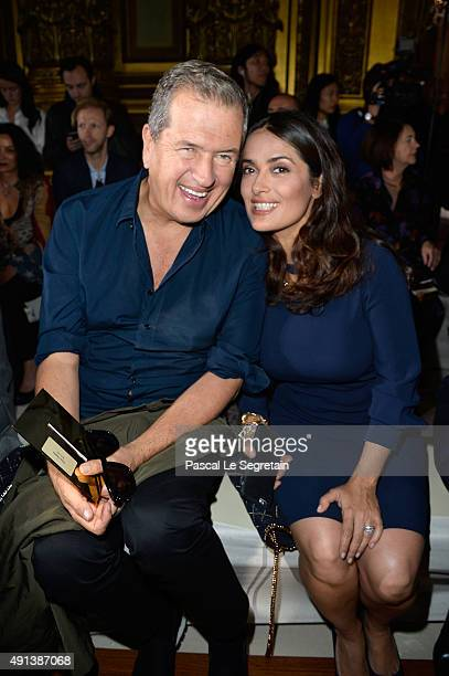 Photographer Mario Testino and actress Salma Hayek attend the Stella McCartney show as part of the Paris Fashion Week Womenswear Spring/Summer 2016...
