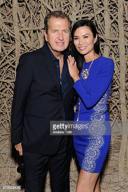 Photographer Mario Testino and Wendi Murdoch attend Liu Wen Wendi Murdoch Laurent Claquin x Qeelin Host A Private Cocktail Party To Celebrate The Met...