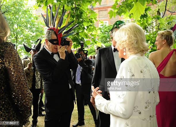 Photographer Mario Testino photographs Camilla Duchess of Cornwall as Prince Charles Prince of Wales and Camilla Duchess of Cornwall host a reception...