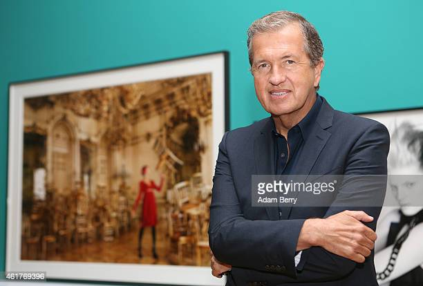 Photographer Mario Testino poses inside the 'Mario Testino In Your Face Private View' exhibition at the Kunstbibliothek on January 19 2015 in Berlin...