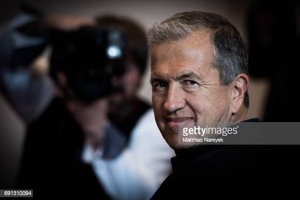 Photographer Mario Testino poses prior to the opening of the exhibition 'Mario Testino Undressed/Helmut Newton Unseen/Jean Pigozzi Pool Party' at...