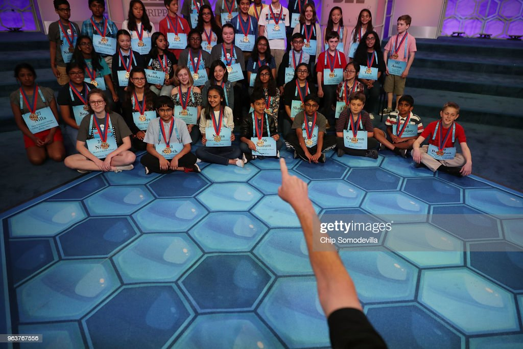 Photographer Mark Bowen directs the 41 finalists for an image at the conclusion of the third day of the 91st Scripps National Spelling Bee at the Gaylord National Resort and Convention Center May 30, 2018 in National Harbor, Maryland. 516 spellers from across the country and around the world competed in the bee.