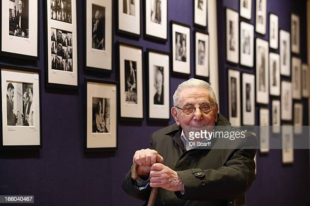 Photographer Mark Gerson poses for a picture with a selection of his images of writers in Bonhams auction house on April 8, 2013 in London, England....