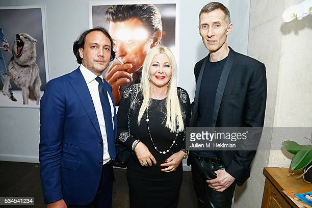 Photographer Markus Klinko attends his exhibition opening with Monika Bacardi and David Swaelens Kane at Artcube Galery on May 26 2016 in Paris France