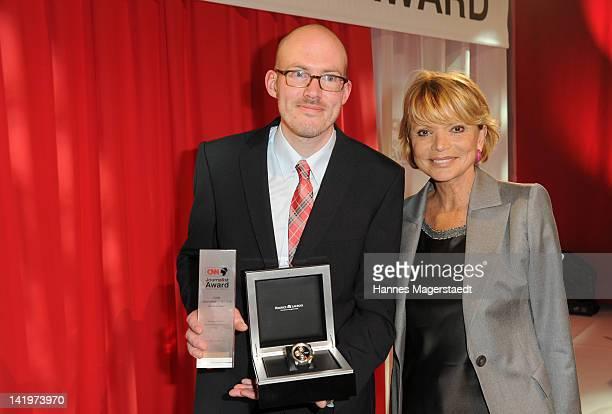 Photographer Martin Schlueter and actress Uschi Glas attend the CNN Journalist Award 2012 at the GOP Variete Theater on March 27, 2012 in Munich,...