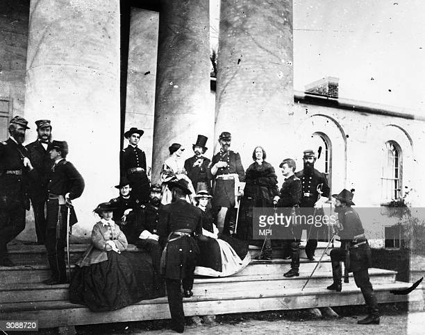Photographer Mathew Brady in top hat stands next to General Samuel P Heintzelman on the steps of the former Lee mansion in Arlington Virginia...
