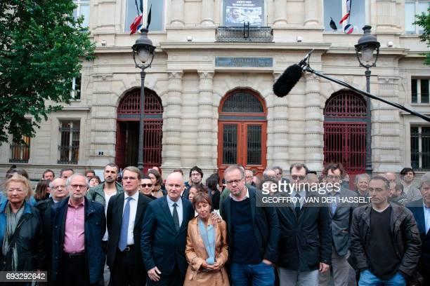 Photographer Mathias Depardon's mother, Daniele Van de Lanotte , poses for a photograph with Paris 4th district's mayor Christophe Girard and...