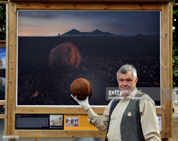 Photographer Michael StMaur Sheil holds the 'Loos Football' in front of his picture of the ball at Loos which was kicked across no man's land by...