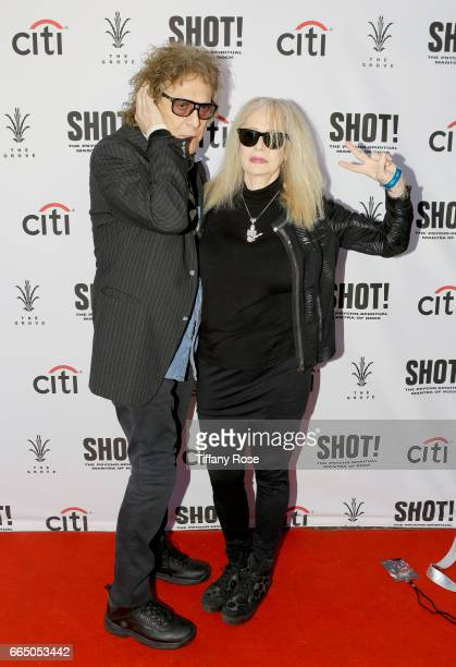 Photographer Mick Rock and director Penelope Spheeris attend 'Shot The Psycho Spiritual Mantra of Rock' LA Premiere Presented by Citi at The Grove on...
