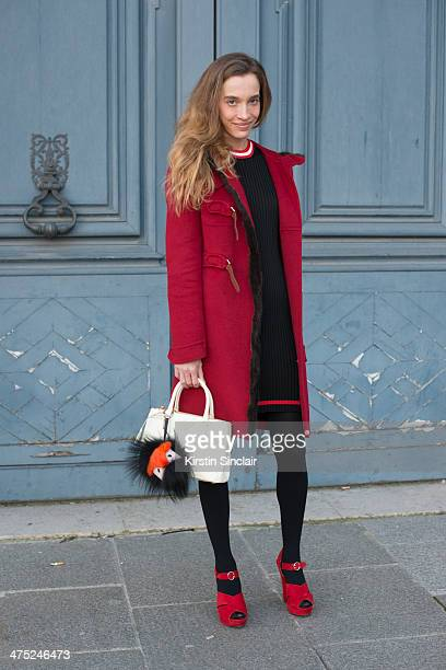 Photographer Micol Sabbadini wears a Fendi pom pom and everything else Prada on day 2 of Paris Collections Women on February 26 2014 in Paris France