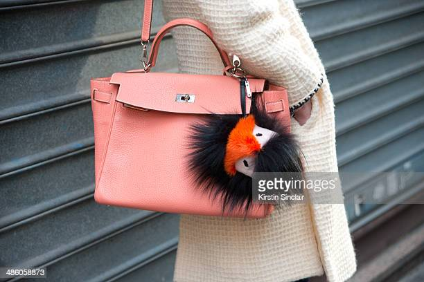 Photographer Micol Sabbadini wears a vintage Chanel jacket Hermes bag Fendi Monster Pom Pom on day 5 of Paris Collections Women on March 01 2014 in...