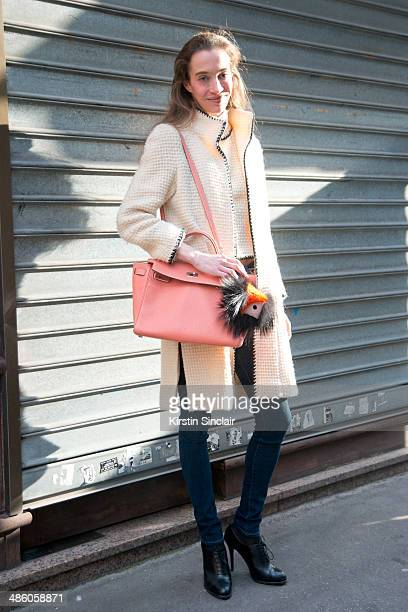 Photographer Micol Sabbadini wears a vintage Chanel top and jacket Hermes bag Fendi Monster Pom Pom Ralph Lauren shoes and Citizen of Humanity jeans...