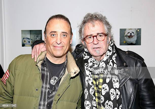 Photographer Mike Pont and Jimi Celeste attend a pet portrait exhibition by Getty Images staff photographer Jamie McCarthy to benefit Animal Care...
