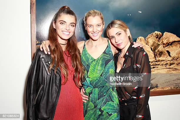 Photographer Monroe model Taylor Reynolds and DJ Kate attend the Photo Femmes Exhibition Opening at De Re Gallery featuring the work of Ashley Noelle...