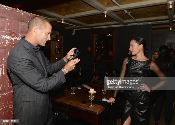 Photographer Nigel Barker and Cristen Barker attend Modelinia Fashion Week Dinner at Freemans on September 8 2013 in New York City