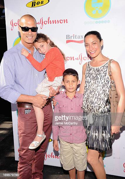 Photographer Nigel Barker and his wife Cristen Barker pose with their children at the 2013 Baby Buggy Bedtime Bash hosted by Jessica and Jerry...