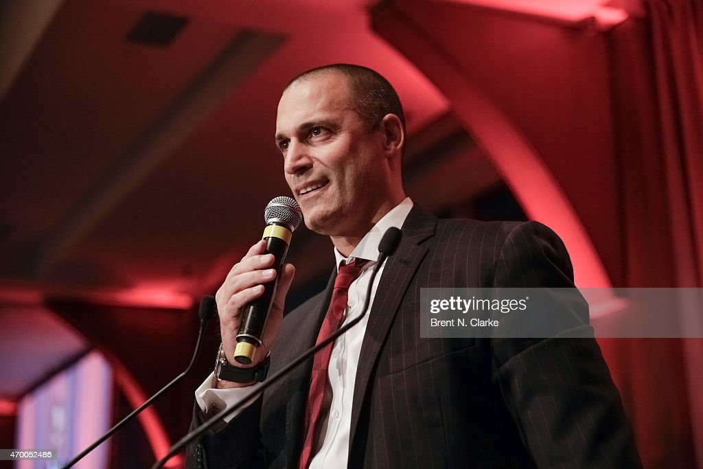 Photographer Nigel Barker conducts a live auction from the stage during the Scribbles To Novels 10th Anniversary Gala held at Pier Sixty at Chelsea Piers on April 16, 2015 in New York City.